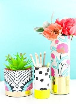 Wrapped Patterned Vases  .  Free tutorial with pictures on how to make a vase in under 10 minutes using adhesive, wallpaper, and glass vase . Inspired by flowers. How To posted by Kara W.  in the Decorating section Difficulty: Simple. Cost: 3/5. Steps: 2