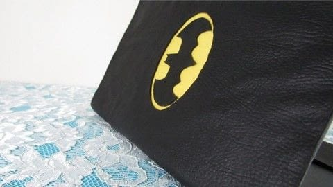 Make this Batman notebook cover .  Free tutorial with pictures on how to make stationery in under 30 minutes by not sewing with synthetic leather, fabrics, and white glue. Inspired by batman. How To posted by bora FAZER.  in the Home + DIY section Difficulty: Simple. Cost: Cheap. Steps: 1