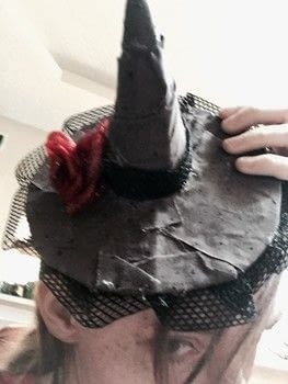 I'm the witch of scraps!!!! .  Make a character hat in under 45 minutes by constructing, decorating, embellishing, and not sewing with cardboard, hair band, and embellishments. Inspired by halloween and witches & wizards. Creation posted by Kinhime Dragon.  in the Decorating section Difficulty: Easy. Cost: No cost.