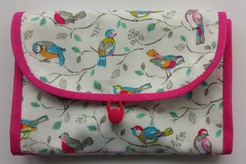 Cute purse for all my sewing bits and bobs .  Sew a roll-up pouch in under 131 minutes by sewing, hand sewing, and machine sewing with fabric, bias binding, and buttons. Creation posted by Delicate Stitches.  in the Sewing section Difficulty: Simple. Cost: Cheap.
