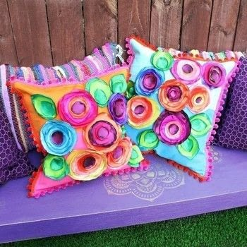 Make super colorful no sew boho flower pillows! .  Free tutorial with pictures on how to make a pillow in 4 steps by upholstering and not sewing with taffeta, e-6000 glue, and trim. How To posted by Mark Montano.  in the Sewing section Difficulty: Simple. Cost: Cheap.