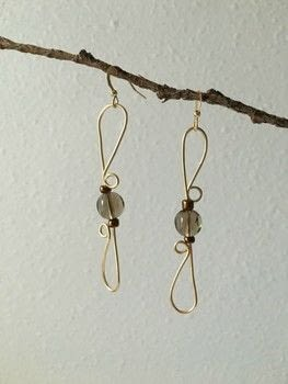 Gold Wire Wrap Earrings with Beads .  Free tutorial with pictures on how to make a pair of wire earrings in under 60 minutes by jewelrymaking and wireworking with beads, earring hooks, and wire cutters. How To posted by Adrienne the Crafty Little Gnome.  in the Jewelry section Difficulty: 3/5. Cost: Cheap. Steps: 6