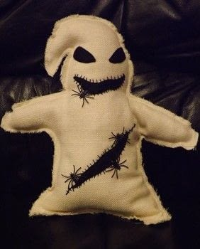Nightmare Before Christmas Plush .  Sew a movie plushie in under 120 minutes by machine sewing with fabric, plastic spiders or bugs, and felt. Inspired by halloween and nightmare before christmas. Creation posted by PixieFey.  in the Sewing section Difficulty: Easy. Cost: Absolutley free.