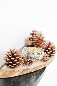 DIY Candle Holder .  Free tutorial with pictures on how to make a votive / candle holder in under 15 minutes by decorating with pine cones, wood, and hot glue gun. How To posted by Ela BellaWorld.  in the Home + DIY section Difficulty: Easy. Cost: Cheap. Steps: 1