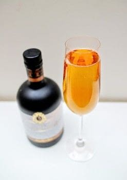 A Kir Royale with a regal twist! .  Free tutorial with pictures on how to mix a champagne cocktail in under 5 minutes by mixing drinks with liqueur, sloe gin, and champagne. Recipe posted by Cat Morley.  in the Recipes section Difficulty: Simple. Cost: Cheap. Steps: 4