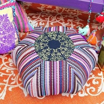 Rag Rug Floor Pouf DIY .  Free tutorial with pictures on how to make a shaped cushion in 3 steps by creating, needleworking, stencilling, and sewing with rag, cotton fabric, and americana decor mandala stencil. How To posted by Mark Montano.  in the Sewing section Difficulty: 3/5. Cost: 3/5.
