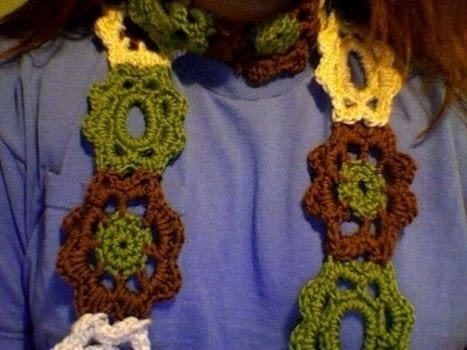Circled in Flowers .  Crochet a granny square scarf in under 60 minutes by yarncrafting and crocheting with yarn, crochet hook, and needle. Inspired by flowers. Creation posted by Melissa Beth.  in the Yarncraft section Difficulty: Simple. Cost: Cheap.