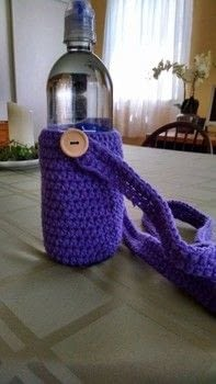 Fits a 23.7oz water bottle .  Free tutorial with pictures on how to stitch a knit or crochet bag in under 120 minutes using scissors, thread, and worsted weight yarn. How To posted by Violette Lovelace.  in the Yarncraft section Difficulty: Easy. Cost: Absolutley free. Steps: 4