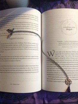Make reading just a little more magical. .  Make a bookmark in under 15 minutes by jewelrymaking with chain, beads, and jump rings. Creation posted by FallenBeyond.  in the Other section Difficulty: Easy. Cost: Absolutley free.