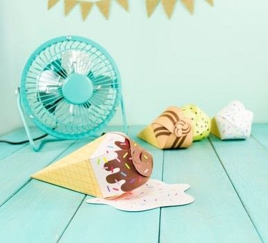 DIY Printable Ice Cream Cone Favors .  Free tutorial with pictures on how to cut a piece of papercutting in under 15 minutes Inspired by birthdays, summer holidays, and ice cream. How To posted by Alle C.  in the Papercraft section Difficulty: Easy. Cost: No cost. Steps: 4