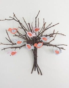 Learn how to repurpose twigs that are all over your front and back yard. .  Free tutorial with pictures on how to make a twig ornament in under 60 minutes by decorating with twigs , thread, and scissors. Inspired by trees and twiggy. How To posted by Queti A.  in the Home + DIY section Difficulty: Simple. Cost: Absolutley free. Steps: 10