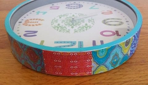 Turn a plain wall clock to a boho look. .  Free tutorial with pictures on how to make a clock in under 45 minutes by decoupaging and decorating with clock, acrylic paint, and paintbrush. Inspired by bohemian. How To posted by Queti A.  in the Decorating section Difficulty: Simple. Cost: Absolutley free. Steps: 9
