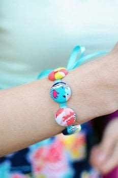 Use your fabric scraps to create a cool bracelet! .  Free tutorial with pictures on how to make a button bracelet in under 25 minutes by jewelrymaking with fabric, cover button kit, and ribbon. How To posted by Jen R.  in the Jewelry section Difficulty: Simple. Cost: Cheap. Steps: 14