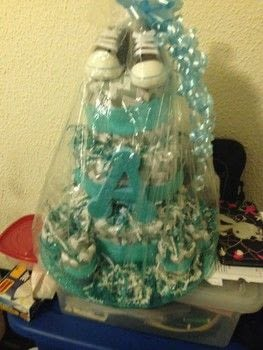 When there's a baby shower..here comes the diapers .  Make a diaper cakes in under 120 minutes by decorating with paper, hot glue gun, and bow. Creation posted by Elizabeth B.  in the Other section Difficulty: Simple. Cost: 3/5.