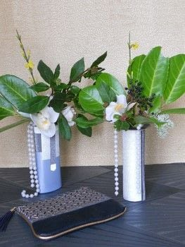 Unexpensive vases for a Great Gatsby themed party .  Free tutorial with pictures on how to make a beaded bouquet in under 11 minutes by decorating with shampoo, greenery, and fabric flower. How To posted by campaspe.  in the Decorating section Difficulty: Easy. Cost: Absolutley free. Steps: 2