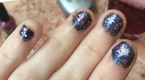 Made possible by a happy accident .  Paint a glitter nail in under 10 minutes by creating, applying makeup, and nail painting with black nail polish, nail polish, and white nail polish. Inspired by space. Creation posted by Kinhime Dragon.  in the Beauty section Difficulty: Easy. Cost: No cost.