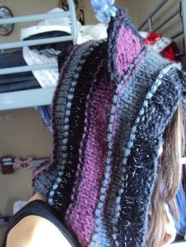 From the Cheshire Cat Hood found on Pinterest .  Free tutorial with pictures on how to make a piece of headwear in under 180 minutes using super bulky yarn, yarn needle, and knitting needles. Inspired by cats. How To posted by FallenBeyond.  in the Yarncraft section Difficulty: Simple. Cost: 3/5. Steps: 21