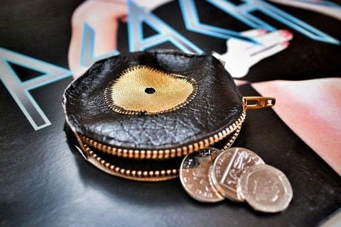 Keep your pennies safe with a vinyl record coin purse! .  Free tutorial with pictures on how to make a zipper pouch in under 120 minutes by sewing with zipper, leather, and leather. How To posted by Cat Morley.  in the Sewing section Difficulty: 3/5. Cost: Cheap. Steps: 16