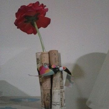Flower on display. .  Make a vase, pot or planter in under 10 minutes using wine corks, cardboard, and ribbon. Creation posted by Ashley P.  in the Other section Difficulty: Simple. Cost: Cheap.