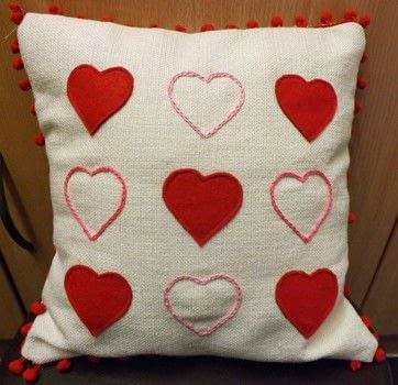 Valentine Pillow .  Free tutorial with pictures on how to make a cushion in under 120 minutes by machine sewing with cushion pad, fabric, and felt. Inspired by valentine's day and hearts. How To posted by PixieFey.  in the Sewing section Difficulty: Easy. Cost: Cheap. Steps: 3