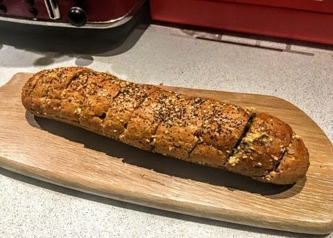 Super simple garlic bread! .  Free tutorial with pictures on how to bake garlic bread in under 10 minutes by baking with baguette, garlic cloves, and butter. Recipe posted by Cat Morley.  in the Recipes section Difficulty: Simple. Cost: Cheap. Steps: 5