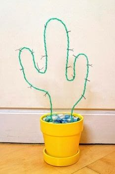 Light up your house with an EL wire neon cactus! .  Free tutorial with pictures on how to make a decorative light in under 120 minutes by decorating with el wire, plant pot, and acrylic. Inspired by cactus. How To posted by Cat Morley.  in the Home + DIY section Difficulty: Simple. Cost: Cheap. Steps: 20
