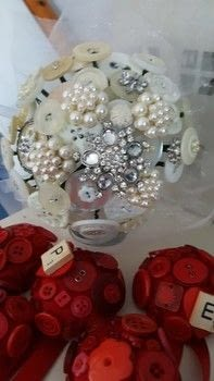Stunning keepsake bouquet  .  Make a button bouquet in under 120 minutes by wireworking and hand sewing with  buttons, floral wire, and tape. Inspired by weddings. Creation posted by LoupLou.  in the Other section Difficulty: 3/5. Cost: 3/5.