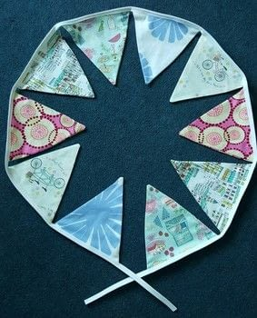 Traditional bunting .  Make a bunting / garland in under 30 minutes by sewing with fabrics, bias binding, and thread. Inspired by picnic. Creation posted by LoupLou.  in the Sewing section Difficulty: Simple. Cost: Cheap.
