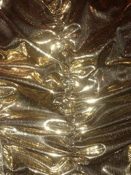Gold, metallic, gold lame', 80's, 1980's, rock, rocker, goth, edgy, retro, club kid, .  Make a shirt by sewing and machine sewing with polyester fabrics, liquid, and elastic. Creation posted by Mike M.  in the Sewing section Difficulty: 4/5. Cost: 3/5.