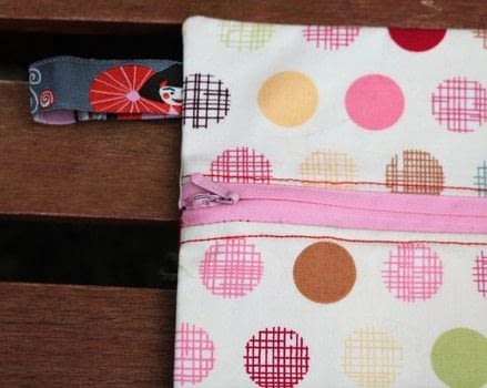 Zip pouch .  Make a storage unit in under 150 minutes by sewing with lining fabric, fat quarter, and thread. Creation posted by js-m crafts.  in the Sewing section Difficulty: 3/5. Cost: 3/5.