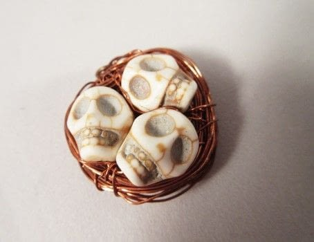 Skull beads with copper wire .  Make a skull pendant in under 30 minutes by wireworking with beads, copper wire, and wire cutter. Inspired by skulls & skeletons. Creation posted by Lindsay A.  in the Jewelry section Difficulty: Simple. Cost: Cheap.