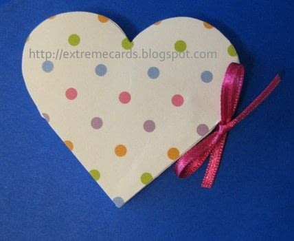 Make a little heart shaped card with a surprise inside .  Free tutorial with pictures on how to make a greetings card in under 60 minutes by papercrafting and cardmaking with cardstock, decorative paper, and color printer. Inspired by valentine's day. How To posted by Carol .  in the Papercraft section Difficulty: 3/5. Cost: Cheap. Steps: 8