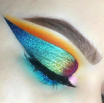 This is my version of an oil-slick look.  .  Free tutorial with pictures on how to create a black eye makeup loop in under 35 minutes by applying makeup with eyeliner. How To posted by Emily Casanova Makeup.  in the Beauty section Difficulty: 4/5. Cost: 3/5. Steps: 9