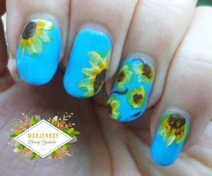 Create beautiful sunflowers on your nails easily! .  Free tutorial with pictures on how to paint a nail painting in under 60 minutes using nail polish, acrylic paint, and nail art brushes. Inspired by flowers and floral. How To posted by Jennifer R.  in the Beauty section Difficulty: 3/5. Cost: Cheap. Steps: 1