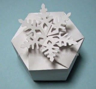 Make a little box with interlocking closure that forms a snowflake. .  Free tutorial with pictures on how to fold an origami box in under 60 minutes by papercrafting with cardstock, cutting machine, and craft knife. Inspired by gifts and snowflakes. How To posted by Carol .  in the Papercraft section Difficulty: 3/5. Cost: Cheap. Steps: 5