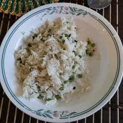 Coconut Rice With Green Onions And Frozen Peas