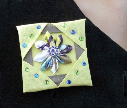 Make yourself this fabric brooch .  Free tutorial with pictures on how to sew a fabric flower brooches in under 60 minutes using fabric scraps, pearls, and cardboard. How To posted by campaspe.  in the Beauty section Difficulty: Simple. Cost: Absolutley free. Steps: 3