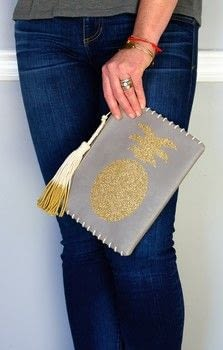 15 minutes is all you need to create this custom clutch! .  Free tutorial with pictures on how to make a leather clutch in under 15 minutes using metallic paint, cricut, and cricut. Inspired by pineapples. How To posted by Kingston Crafts.  in the Other section Difficulty: Simple. Cost: Cheap. Steps: 4