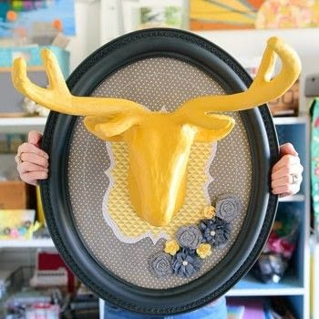 Yard Sale Frame to Fun Home Decor .  Free tutorial with pictures on how to make a taxidermy mount in under 180 minutes using frame, spray paint, and wrapping paper. How To posted by Kingston Crafts.  in the Home + DIY section Difficulty: 4/5. Cost: 3/5. Steps: 7