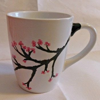 Japanese Sakura/ Cherry Blossom inspired mug .  Free tutorial with pictures on how to make a cup / mug in 10 steps by decorating with porcelain pen, porcelain pen, and porcelain pen. Inspired by kitchen, japanese, and cherry. How To posted by Emma H.  in the Home + DIY section Difficulty: Simple. Cost: Cheap.