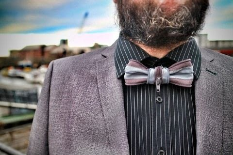 Transform three old zippers into a hipster bow-tie! .  Free tutorial with pictures on how to make a bow tie in under 45 minutes by sewing with zipper, sewing machine, and velcro. How To posted by Cat Morley.  in the Sewing section Difficulty: Simple. Cost: Cheap. Steps: 10