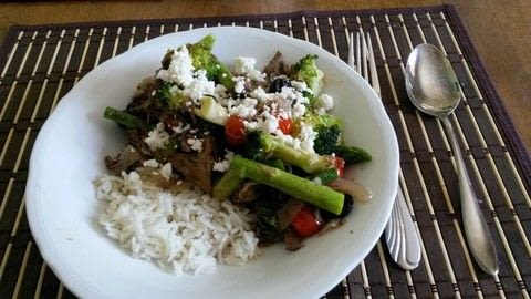 Not totally vegetarian but close .  Free tutorial with pictures on how to cook a stir fry in under 40 minutes using meat, garlic cloves, and fresh ginger. Recipe posted by Miss_Fit.  in the Recipes section Difficulty: Easy. Cost: 3/5. Steps: 4