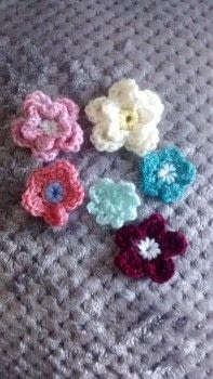 Crochet flower .  Stitch a knit or crochet flower brooch in under 20 minutes by crocheting with yarn and crochet hook. Creation posted by Ayjay.  in the Yarncraft section Difficulty: Easy. Cost: No cost.