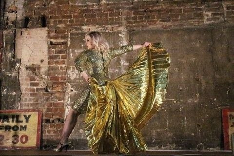 Fluttering into fabulousness .  Sew a costume dress in under 180 minutes by hand sewing with materials, gluestick, and glue gun. Inspired by burlesque & pinup and egypt. Creation posted by Markee R.  in the Needlework section Difficulty: 3/5. Cost: 3/5.