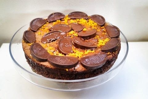 Chocolate orange cheesecake with a biscuit base and orange syrup .  Free tutorial with pictures on how to bake a cheesecake in under 60 minutes by cooking and baking with digestive biscuits, orange, and butter. Recipe posted by Cat Morley.  in the Recipes section Difficulty: Simple. Cost: 3/5. Steps: 17