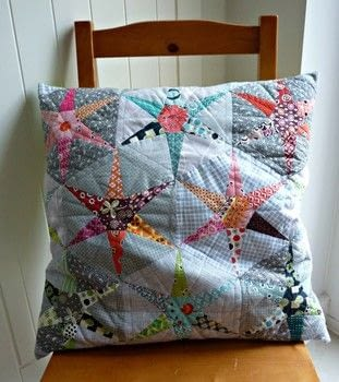 Quirky hexagon star patchwork .  Free tutorial with pictures on how to sew a patchwork cushion in under 60 minutes by sewing and patchworking with fabric and paper. How To posted by Reene at Nellie's Niceties.  in the Sewing section Difficulty: 3/5. Cost: Absolutley free. Steps: 3