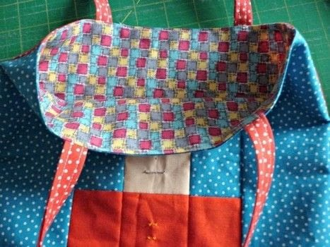 "A quick and cute project for a last minute gift .  Free tutorial with pictures on how to sew a patchwork tote in under 90 minutes by sewing and patchworking with pdf instructions, 1"" x 2 1/2"" yellow solid, and 2 1/2"" x 3 1/2"" black solid. How To posted by Reene at Nellie's Niceties.  in the Sewing section Difficulty: Simple. Cost: Absolutley free. Steps: 9"