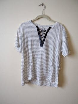 Transform a plain t-shirt into this fun lace-up style shirt! .  Free tutorial with pictures on how to make a revamped t-shirt in under 60 minutes using ribbon, shirt, and fabric glue. How To posted by Haley  R.  in the Home + DIY section Difficulty: Simple. Cost: Cheap. Steps: 3