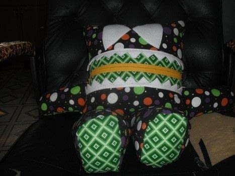 These are Pajama monsters that I made for my youngest.  I bought and downloaded the pattern online.  These are very fun and easy to make and a great way to use up scrap material. .  Free tutorial with pictures on how to make a baby plushie in under 120 minutes by sewing, patchworking, and machine sewing with fleece, poly fill stuffing, and zippers. How To posted by Brenda L.  in the Sewing section Difficulty: Easy. Cost: No cost. Steps: 3