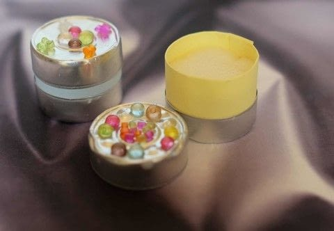 Never wondered about what you can do with these tea lights aluminium caps ? Here are some ideas .  Free tutorial with pictures on how to make a misc in under 10 minutes using cups, cardboard, and plastic beads. How To posted by campaspe.  in the Other section Difficulty: Easy. Cost: No cost. Steps: 2